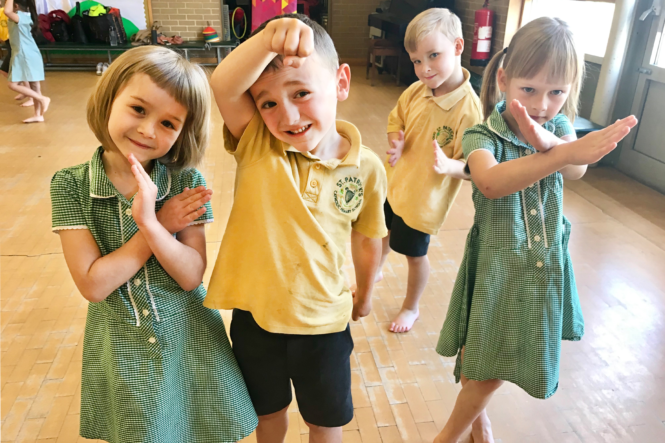 group of children holding dance poses